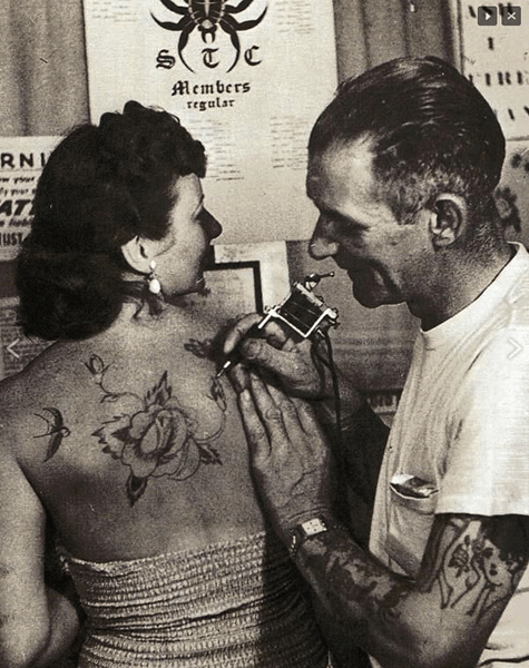Sailor Jerry Tattooing a Woman