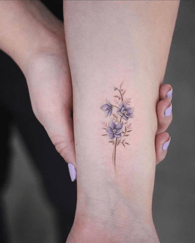 Realistic Small Flower Tattoo Design