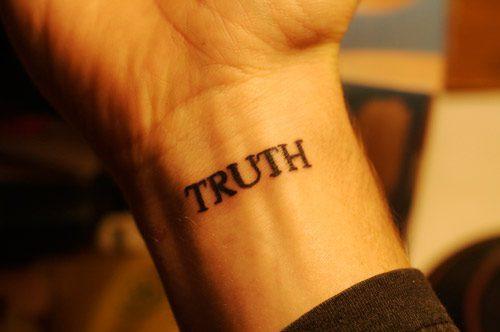 TRUTH Wrist Tattoo in a Serif Font