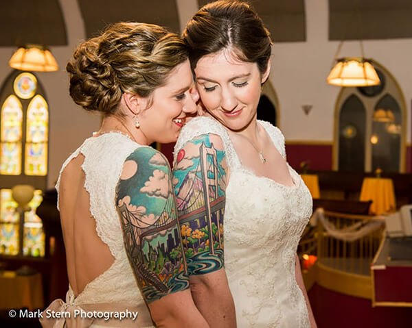 San Francisco Bridge Tattoo Sleeves on a Couple