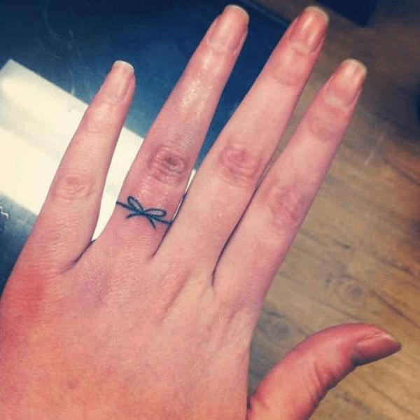 Black Minimalist Bow on Finger
