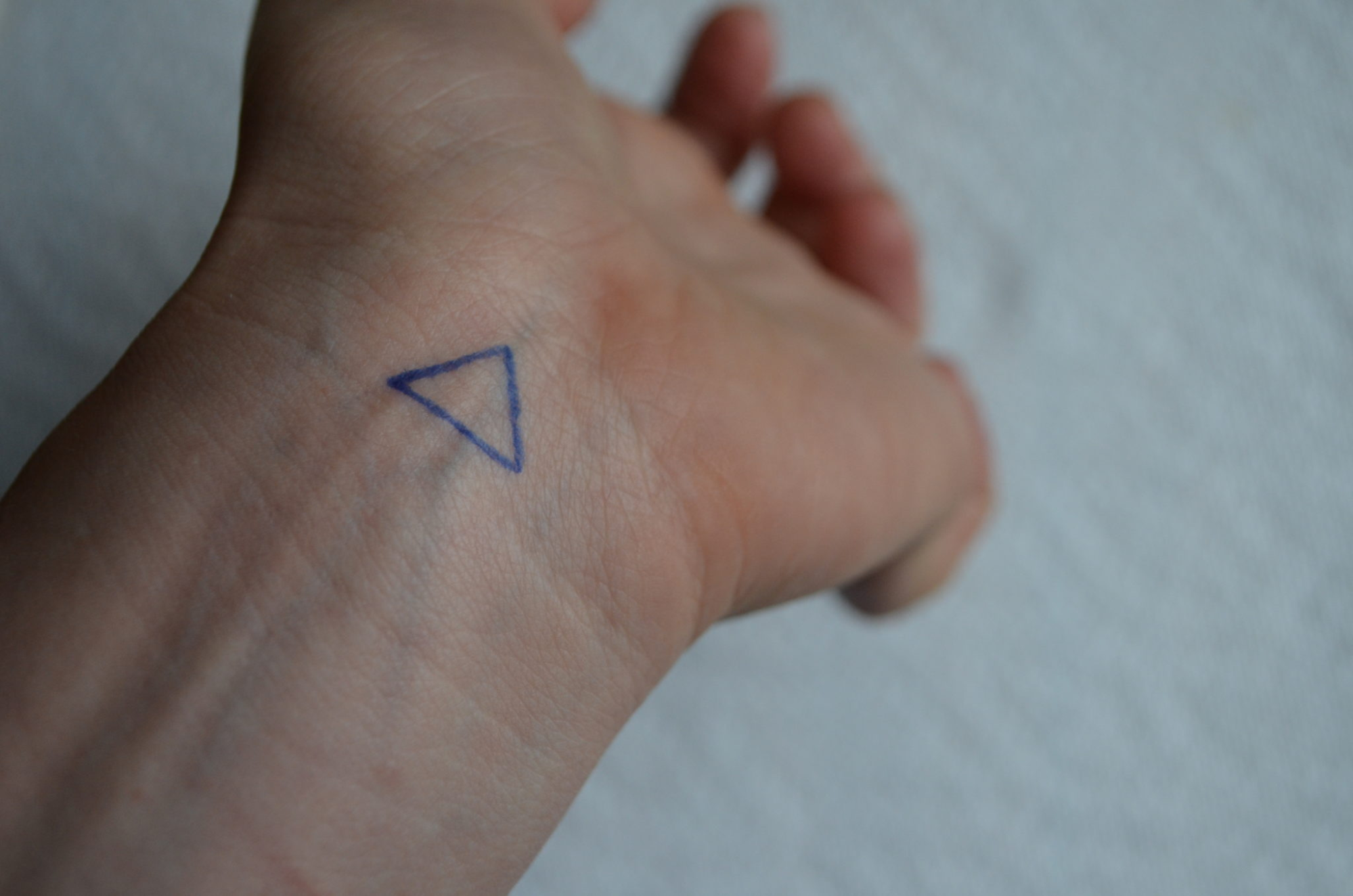 Small Triangle Wrist Tattoo Design Idea